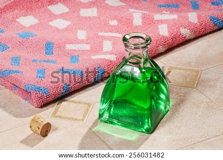 a flacon with bath towel - stock photo