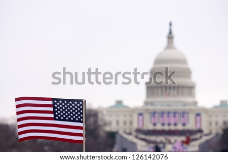 A flag is waved at the inauguration ceremony in 2013 for Barack Obama. - stock photo