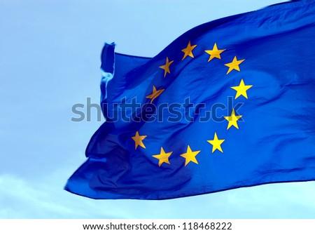 A flag of the European Union against the sky - stock photo