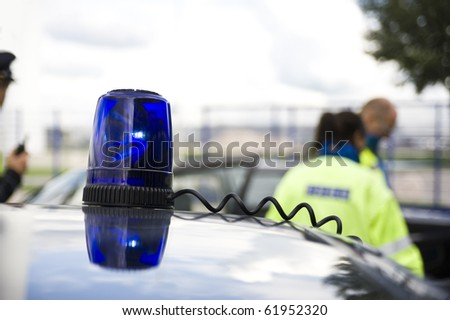 a flashing light on a police car.