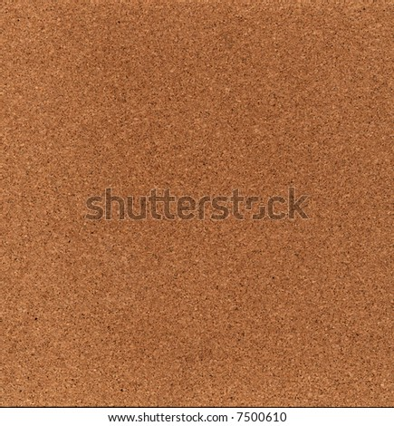 A flat piece of a cork board, suitable for a background texture. - stock photo