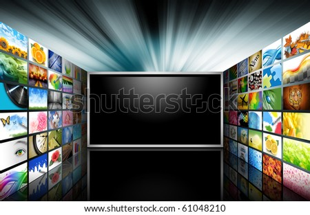 A flat screen television has a blank black text area with photo images coming out of the sides of it. The tv has a glowing light coming out the top. Use it for a media technology concept. - stock photo