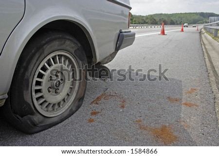 A flat tyre on the highway.