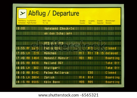 a flight announcement shows time of departure on a screen - stock photo