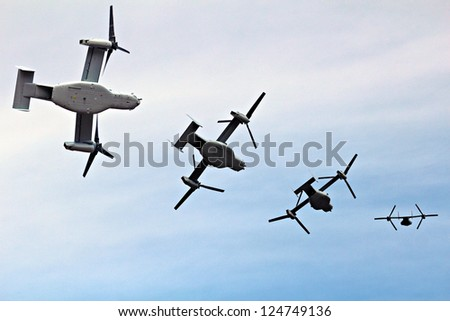 A flight of four osprey military planes - stock photo