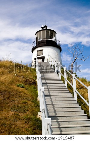 A flight of stairs leads up to the hilltop where the Owls Head Lighthouse stands guard over Penobscot Bay, Maine, near Rockland. - stock photo
