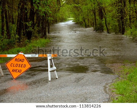 A flooded road in  Texas. - stock photo