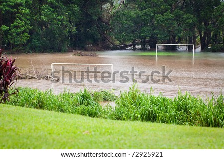 A flooded soccer field after heavy rain in Queensland, Australia - stock photo