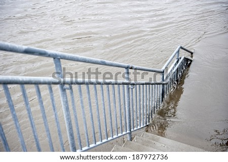 A flooded staircase that leads to a park in the Chicago area. - stock photo