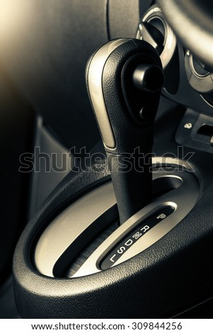 A floor selection lever of car with automatic transmission gear shift - stock photo