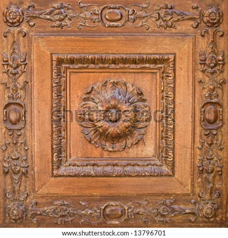 A flower carved in wood. Door decoration - stock photo