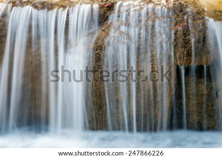 A flowing waterfall - stock photo