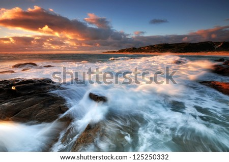 A Flowing Waves at Sunset - stock photo