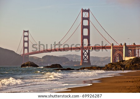 A foggy afternoon on Baker Beach underneath the Golden Gate Bridge in San Francisco California - stock photo