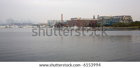A foggy morning dawns, Inner Harbor, Baltimore, Maryland - stock photo
