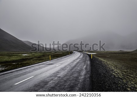 A foggy mountain road in eastern Iceland - stock photo
