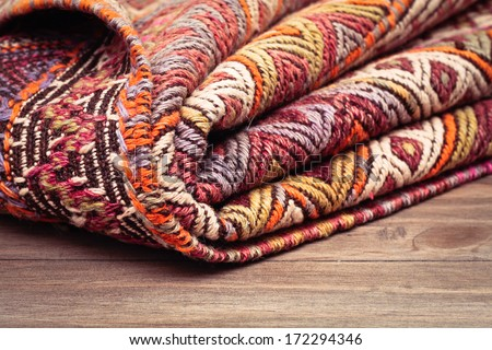 A folded kilim rug  with shallow depth of field - stock photo