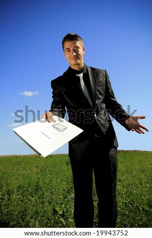 A folder presented to you by a business person in black suit. - stock photo