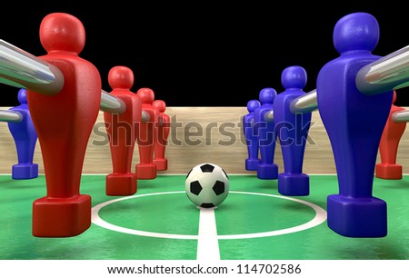 A foosball table at ground level with a soccer ball being competed for by a blue and red team ready to kick off a soccer match - stock photo