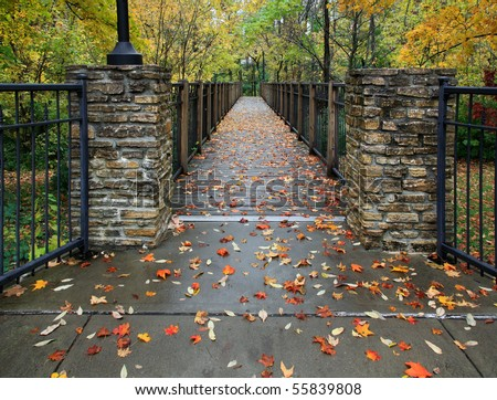 A Foot Bridge On A Rainy Day During Autumn In The Park, Sharon Woods, Southwestern Ohio - stock photo