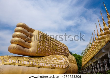 A foot print big statue of reclining buddha image in the temple, Phrae province Thailand - stock photo