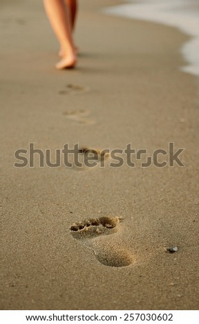 a footprints in the sand - stock photo