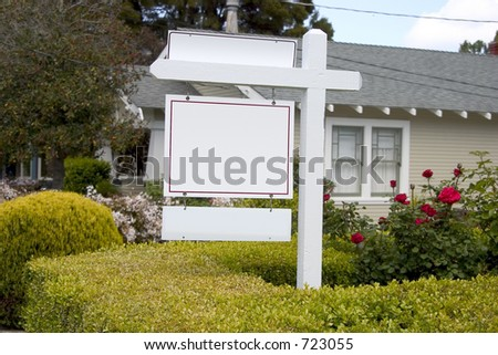 A for sale sign in front of an old crafsman style house.  All the words have been blanked out for the addition of your message. - stock photo