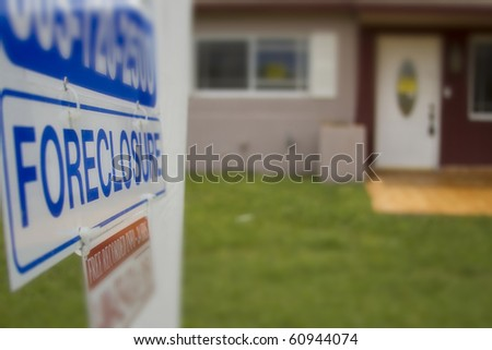 A foreclosure sign outside of a condemned home - stock photo