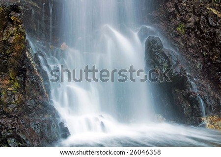 A forest waterfall - stock photo