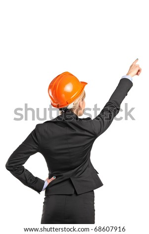 A forewoman in black suit pointing isolated against white background