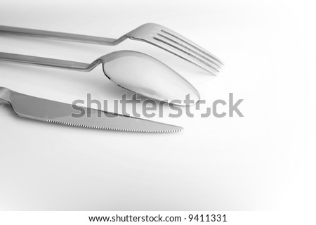 A fork, a knife and a spoon. Black and white image