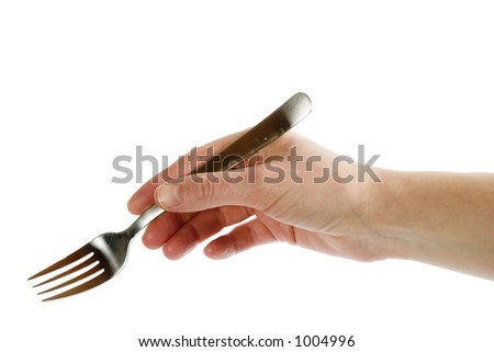 A fork being held by a womans hand. Isolated on white with clipping path. - stock photo
