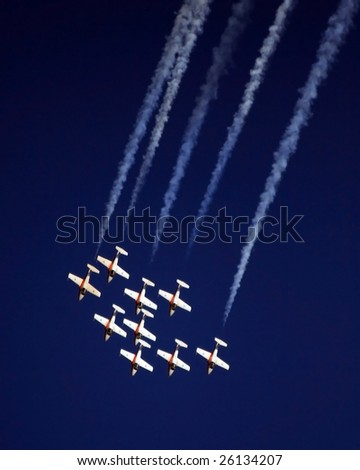 A formation of planes in an air show - stock photo