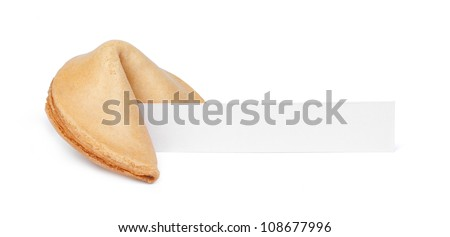 A fortune cookie with a blank piece of paper isolated on white. - stock photo