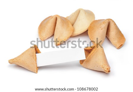 A fortune cookie with fortune paper in front of a few other cookies isolated on white. - stock photo