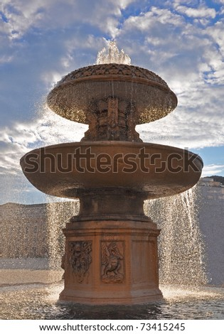 A fountain on the Saint Peters Square - stock photo