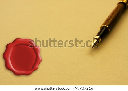 A fountain pen with yellow paper with a wax seal copy-space, Signing a legal agreement - stock photo