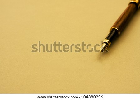 A fountain pen with yellow paper with copy-space, Writing a note