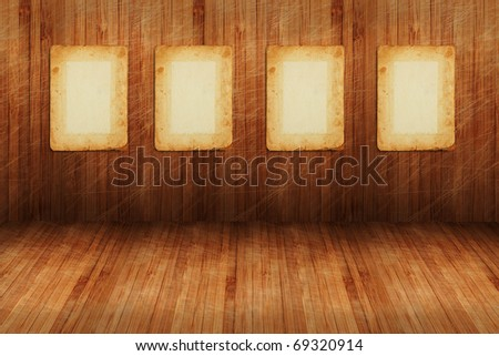 a four empty photo pages on wooden wall as a background or texture - stock photo