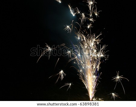 A fourth of July or new years eve ground style fireworks display going off with room for your text - stock photo