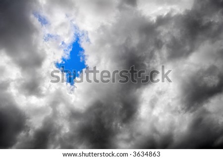 A fragment of a clear sky through the overcast - stock photo