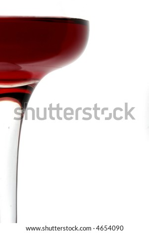 a fragment of a red wine glass with message space