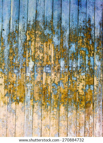 A fragment of an old colored wooden wall - stock photo