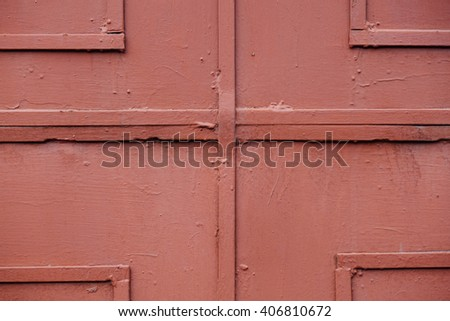 A fragment of an old red iron door, the Soviet Russian Industrial factory, closeup