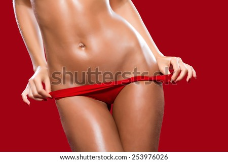 A fragment of woman body in red panties / Lingerie / Underwear/Woman body shape/Female body/Woman body - stock photo
