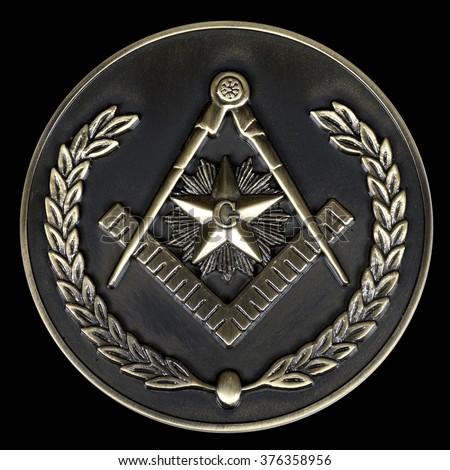 a freemasonry brass medal  square & compass - stock photo