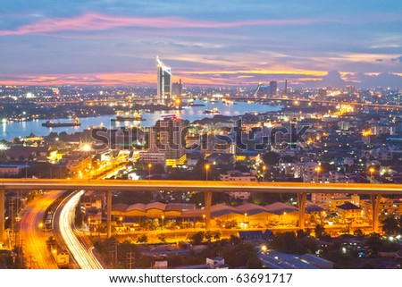 a freeway at dusk along the main river of bangkok thailand - stock photo