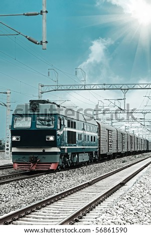 a freight train running on the electrification railroad - stock photo