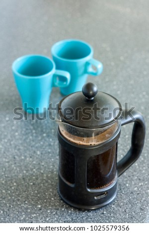 A French press with freshly brewed coffee