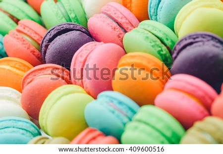 A french sweet delicacy, colourful macaroons variety closeup.Background Texture,vintage tone - stock photo